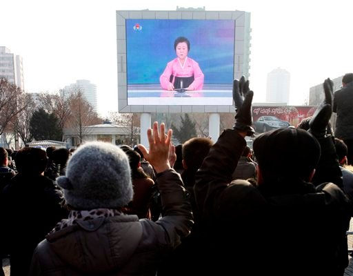 North Koreans watch a news broadcast on a video screen outside Pyongyang Railway Station in Pyongyang, North Korea, Wednesday, Jan. 6, 2016. (AP Photo/Kim Kwang Hyon)