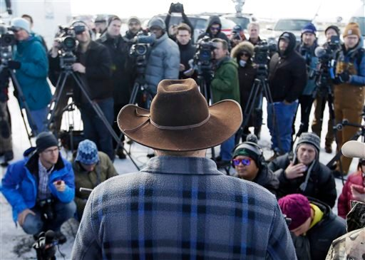 Ammon Bundy, one of the sons of Nevada rancher Cliven Bundy, speaks to reporters during a news conference at Malheur National Wildlife Refuge Wednesday, Jan. 6, 2016, near Burns, Ore. With the takeover entering its fourth day Wednesday, authorities had no