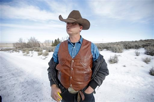 Ryan Bundy, one of the sons of Nevada rancher Cliven Bundy, speaks with a reporter following a news conference at Malheur National Wildlife Refuge on Wednesday, Jan. 6, 2016, near Burns, Ore. With the takeover entering its fourth day Wednesday, authoritie