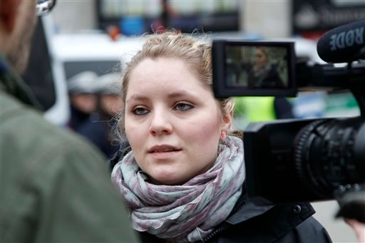 26-year-old student Antonia Rabente a Cologne resident who was not among the victims, attends an interview with The Associated Press in front of the main station in Cologne, Western Germany, on Wednesday, Jan. 6, 2016 where she spoke about the attacks dur