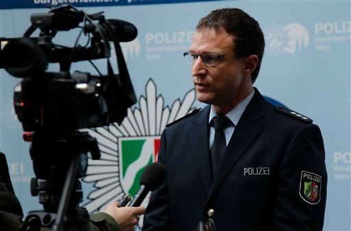 Police spokesman Christoph Gilles speaks during an interview with The Associated Press in Cologne, Germany, Wednesday, Jan. 6, 2016. More women have come forward alleging they were sexually assaulted and robbed during New Year's celebrations in the German