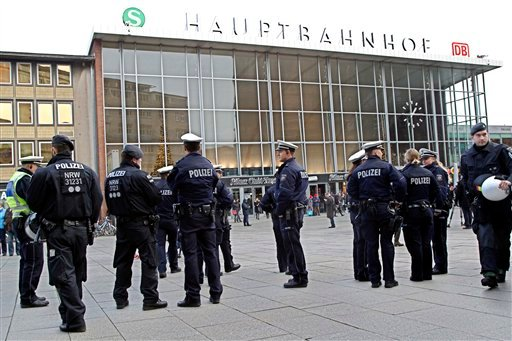 Police officers patrol in front of the main station of Cologne, Germany, on Wednesday, Jan. 6, 2016. More women have come forward alleging they were sexually assaulted and robbed during New Year's celebrations in the German city of Cologne, as police face