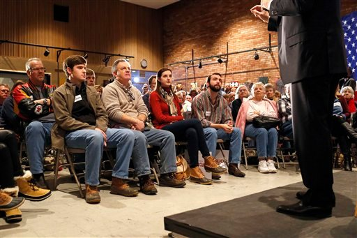 People listen to Republican presidential candidate, Sen. Marco Rubio, R-Fla., right, speaks at a town hall at Fisher Community Center in Marshalltown, Iowa, Wednesday, Jan. 6, 2016. (AP Photo/Patrick Semansky)