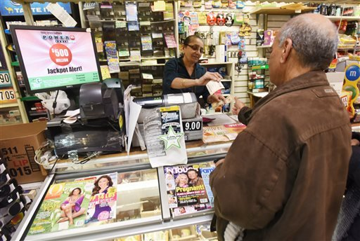 Vilas Patel sells a Powerball ticket to Pravin Bhatt, right, at Leprechaun News in Rutherford, N.J., Wednesday, Jan. 6, 2016. The estimated Powerball jackpot for Wednesday night has soared to $500 million. The last time Powerball had grown this large was