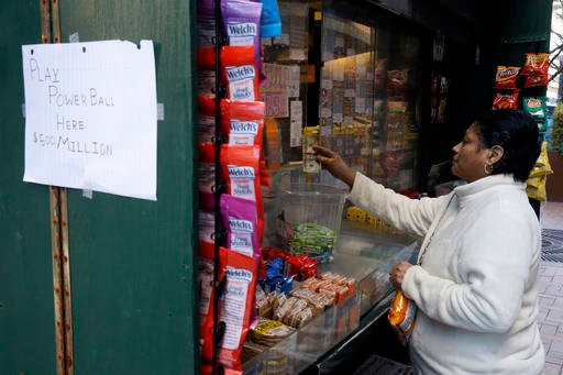 A woman purchase Powerball lottery tickets from a newsstand Wednesday, Jan. 6, 2016, in Philadelphia. Players will have a chance Wednesday night at the biggest lottery prize in nearly a year. (AP Photo/Matt Rourke)