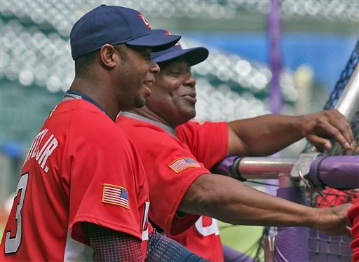 In this Monday March 6, 2006 file photo, Team USA outfielder Ken Griffey, Jr., left and coach Ken Griffey, Sr., right, share a laugh during batting practice at Chase Field in Phoenix. Ken Griffey Sr. said the family was hoping to get the call on his son'