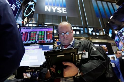 Trader Jeffrey Vazquez works on the floor of the New York Stock Exchange, Thursday, Jan. 7, 2016. U.S. stocks are opening sharply lower as worries intensify about China's economy and dropping oil prices. (AP Photo/Richard Drew)