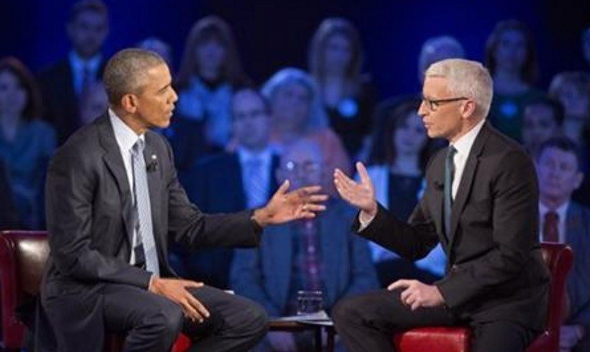 President Barack Obama, left, during a CNN televised town hall meeting hosted by Anderson Cooper, right, at George Mason University in Fairfax, Va., Thursday, Jan. 7, 2016.