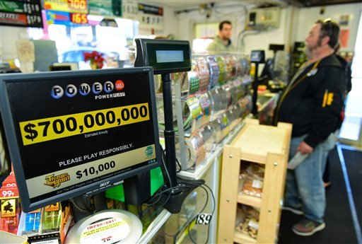 Jerry Clark buys Powerball lotter tickets, Thursday, Jan. 7, 2016 at Bill's Kwik Chek in Chambersburg, Pa. The estimated prize for this weekend's Powerball drawing has grown to about $700 million, making it the largest jackpot of any lottery game in U.S.