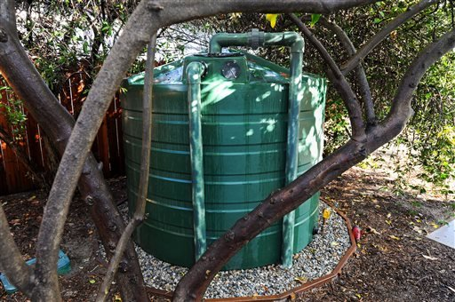 A 1,300 gallon cistern in the backyard of a home in North Hollywood, Calif., Thursday, Jan. 7, 2016, stores rainwater captured from the roof runoff during rain.