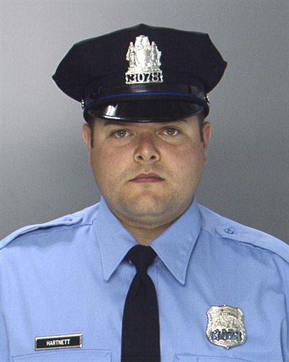 This undated photo provided by the Philadelphia Police Department shows Philadelphia Police Officer Jesse Hartnett.  AP