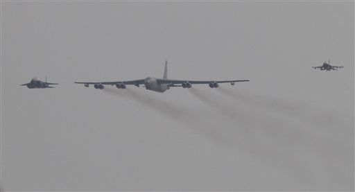 A U.S. Air Force B-52 bomber flies over Osan Air Base in Pyeongtaek, South Korea, Sunday, Jan. 10, 2016. The powerful U.S. B-52 bomber flew low over South Korea on Sunday, a clear show of force from the United States as a Cold War-style standoff deepened