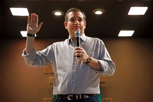 In this Jan. 8, 2016, photo, Republican presidential candidate, Sen. Ted Cruz, R-Texas, holds a town hall at Praise Community Church in Mason City, Iowa. With three weeks to go before Iowa kicks off the 2016 presidential campaign, Donald Trump and Cruz ar