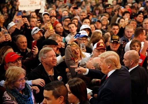 People greet Republican presidential candidate Donald Trump, bottom right, after he spoke at a rally at the Surf Ballroom in Clear Lake, Iowa, Saturday, Jan. 9, 2016. (AP Photo/Patrick Semansky)