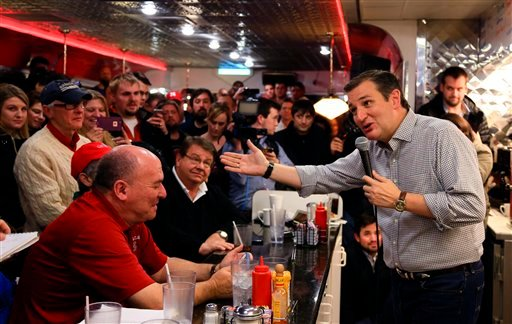 In this Jan 4, 2016 file photo, Republican Presidential candidate, Sen. Ted Cruz, R-Texas, campaigns at Penny's Diner in Missouri Valley, Iowa. Tea party flame-thrower Ted Cruz is showing voters his softer side during his presidential campaign in Iowa, wh