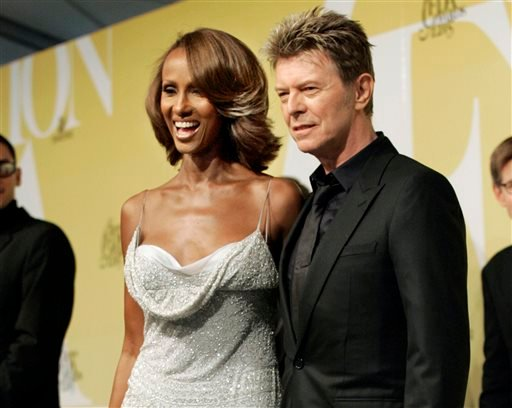 In this June 6, 2005 file photo, singer David Bowie and his wife Iman pose at the 2005 CFDA Fashion Awards in New York.