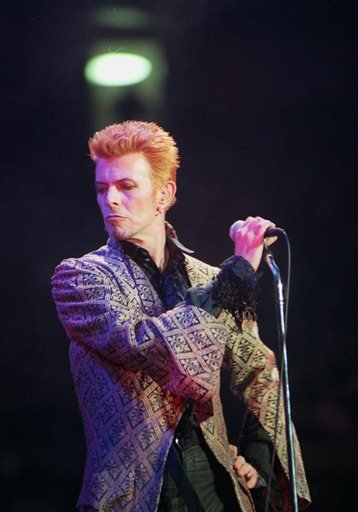 In this Jan. 9, 1997, file photo, David Bowie performs during a concert celebrating his 50th birthday, at Madison Square Garden in New York.