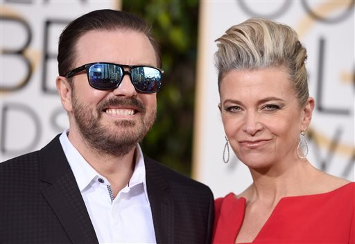 Ricky Gervais, left, and Jane Fallon arrive at the 73rd annual Golden Globe Awards on Sunday, Jan. 10, 2016, at the Beverly Hilton Hotel in Beverly Hills, Calif. (Photo by Jordan Strauss/Invision/AP)
