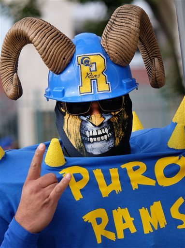 Rams fan Enrique Lopez, arrives for a rally at the historic Los Angeles Memorial Coliseum. Saturday, Jan. 9, 2016 in Los Angeles.