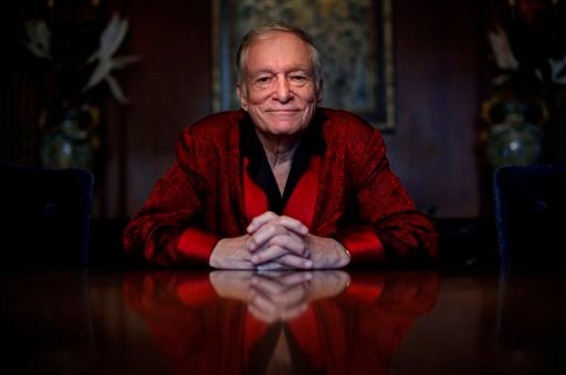 In this Nov. 4, 2010, file photo, Playboy magazine founder Hugh Hefner poses for photos at the Playboy Mansion in Los Angeles.