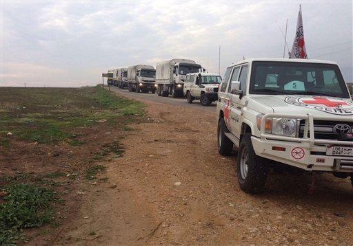 This picture provided by The International Committee of the Red Cross (ICRC), working alongside the Syrian Arab Red Crescent (SARC) and the United Nations (UN), shows a convoy containing food, medical items, blankets and other materials on its way to the