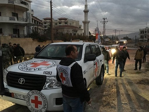 This picture provided by The International Committee of the Red Cross (ICRC), working alongside the Syrian Arab Red Crescent (SARC) and the United Nations (UN), shows a convoy containing food, medical items, blankets and other materials being delivered to