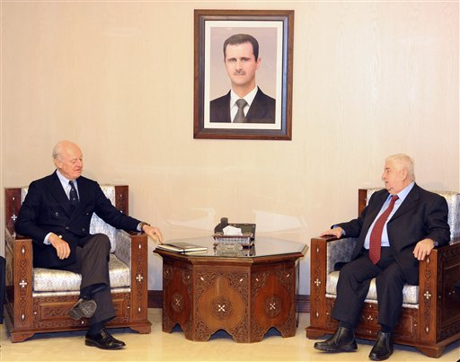 In this photo released by the Syrian official news agency SANA, Syria's Foreign Minister Walid al-Moallem, second right, meets with U.N. Special Envoy for Syria Staffan de Mistura, second left, in Damascus, Syria, Saturday, Jan. 9, 2016. Syria is ready to