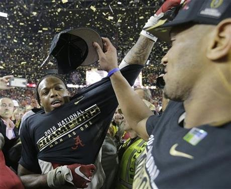 Alabama's Derrick Henry, left, and O.J. Howard celebrate after the NCAA college football playoff championship game against Clemson Monday, Jan. 11, 2016, in Glendale, Ariz. Alabama won 45-40. (AP Photo/Chris Carlson)