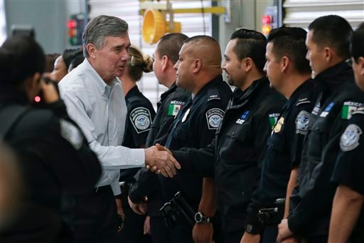 U.S. Customs and Border Protection Commissioner R. Gil Kerlikowske, left, shakes hands with Mexican and US customs officials during an inauguration ceremony for a new border truck inspection station built for both Mexican and U.S. customs.