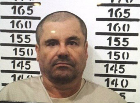"""In this Jan. 8, 2016 image released by Mexico's federal government, Mexico's most wanted drug lord, Joaquin """"El Chapo"""" Guzman, stands for his prison mug shot with the inmate number 3870 at the Altiplano maximum security federal prison in Almoloya, Mexico."""