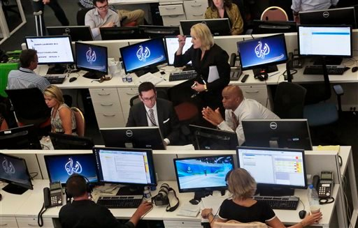 In this Aug. 20, 2013 file photo, Al-Jazeera America editorial newsroom staff prepare for their first broadcast in New York. Cable news network Al Jazeera America says it is shutting down just two-and-a-half years after its launch. Al Jazeera says it will