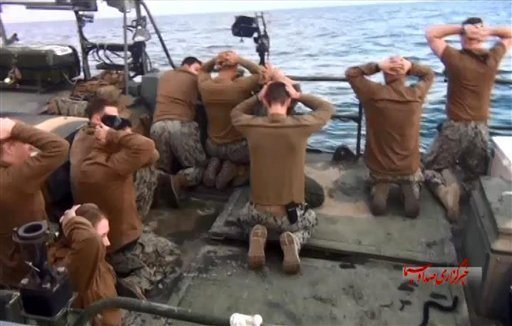 This picture released by the Iranian state-run IRIB News Agency on Wednesday, Jan. 13, 2016, shows detention of American Navy sailors by the Iranian Revolutionary Guards in the Persian Gulf, Iran.