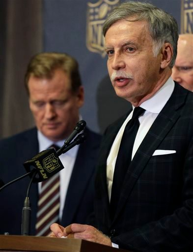 NFL Commissioner Roger Goodell, left, looks down as St. Louis Rams owner Stan Kroenke talks to the media after team owners voted Tuesday, Jan. 12, 2016, in Houston to allow the Rams to move to a new stadium just outside Los Angeles.