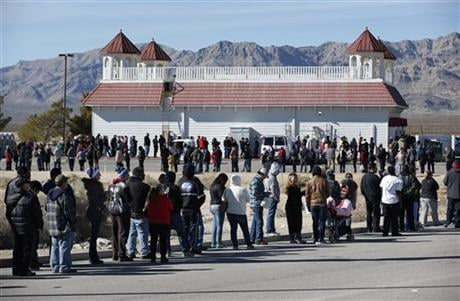 Patrons line up to buy Powerball lottery tickets outside the Primm Valley Casino Resorts Lotto Store just inside the California border Tuesday, Jan. 12, 2016, near Primm, Nev. The Powerball jackpot has grown to over 1 billion dollars for the next drawing
