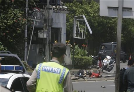 Suicide bombers exploded themselves in downtown Jakarta on Thursday while gunmen attacked a police post nearby, a witness told The Associated Press. Local television reported more explosions in other parts of the city. (AP Photo/Dita Alangkara)