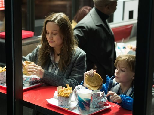 "In this image released by A24 Films, Brie Larson, left, and Jacob Tremblay appear in a scene from the film, ""Room."""