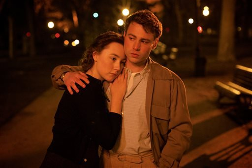 "This photo provided by Fox Searchlight shows Saoirse Ronan, left, and Emory Cohen in a scene from the film, ""Brooklyn."""