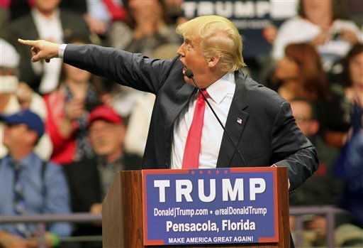 Republican presidential candidate Donald Trump points to the audience as he speaks during a campaign rally at the Pensacola Bay Center in Pensacola, Fla., Wednesday, Jan. 13, 2016. (AP Photo/Michael Snyder)