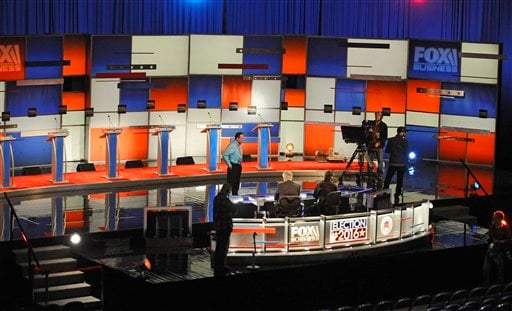 Crew members set the stage at the North Charleston Coliseum, Wednesday, Jan. 13, 2016, in North Charleston, S.C., in advance of Thursday's Fox Business Network Republican presidential debate. (AP Photo/Rainier Ehrhardt)