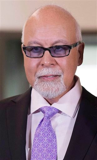 This July 26, 2013 photo shows Rene Angelil in Quebec City. Authorities say Angelil, the husband and manager of Dion, has died in Las Vegas. He was 73 and had battled throat cancer. Clark County Coroner John Fudenberg said his office was notified Thursday
