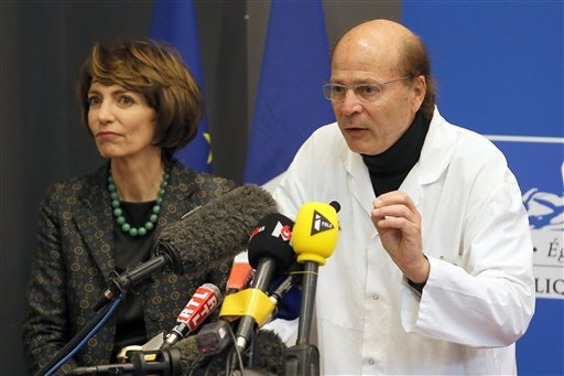 French Health Minister Marisol Touraine, left, and Professor Gilles Edan, the chief neuroscientist at Rennes Hospital, address the media during a press conference held in Rennes, western France, Friday, Jan. 15, 2016.