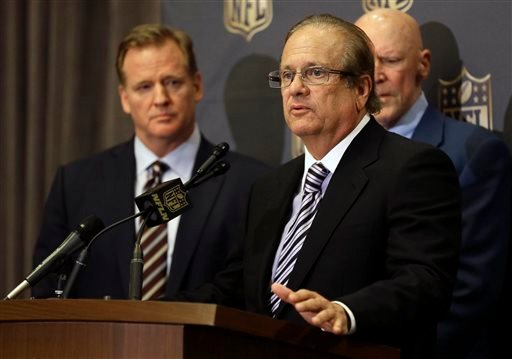 In this Jan. 12, 2016, file photo, NFL Commissioner Roger Goodell, left, listens as San Diego Chargers owner Dean Spanos talks to the media after team owners voted in Houston to allow the St. Louis Rams to move to a new stadium.
