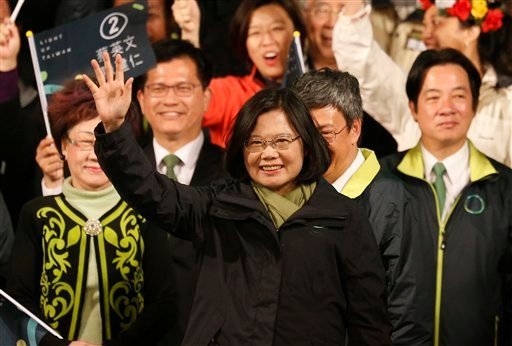 Taiwan's Democratic Progressive Party, DPP, presidential candidate, Tsai Ing-wen, raises her hands as she declares victory in the presidential election Saturday, Jan. 16, 2016, in Taipei, Taiwan. (AP Photo/Wally Santana)