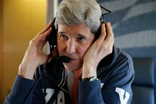 """U.S. Secretary of State, John Kerry, communicates from aboard his plane Saturday, Jan. 16, 2016, on his way to Vienna, Austria on what is expected to be """"implementation day,"""" the day the International Atomic Energy Agency (IAEA) verifies that Iran has met"""