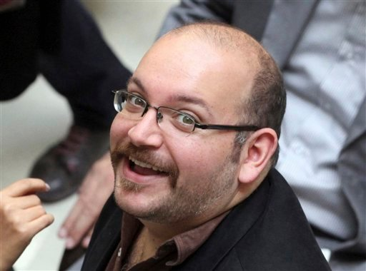 In this April 11, 2013 file photo, Jason Rezaian, an Iranian-American correspondent for the Washington Post, smiles as he attends a presidential campaign of President Hassan Rouhani in Tehran, Iran. Iran state television has reported that the government h