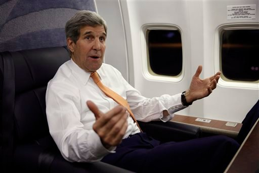 U.S. Secretary of State John Kerry speaks to journalists about his negotiations with Iran upon his arrival from Vienna at Andrews Air Force Base, Md., Sunday, Jan. 17, 2016. The Americans imprisoned by Iran began their journey home Sunday, their friends a