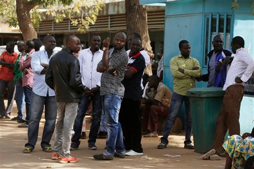 Families of people injured during Saturday's attacks wait to see their loved ones receiving treatment at a hospital in Ouagadougou, Burkina Faso, Sunday, Jan. 17, 2016. The overnight seizure of a luxury hotel in Burkina Faso's capital by al-Qaida-linked e