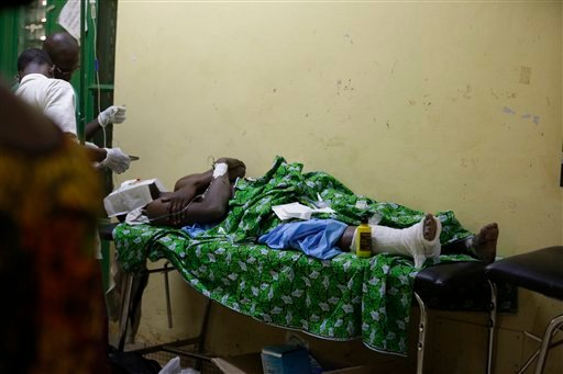 A victim of Saturday's gun attack at the Splendid Hotel receives treatment at a hospital in Ouagadougou, Burkina Faso, Sunday, Jan. 17, 2016. The overnight seizure of a luxury hotel in Burkina Faso's capital by al-Qaida-linked extremists ended Saturday wh