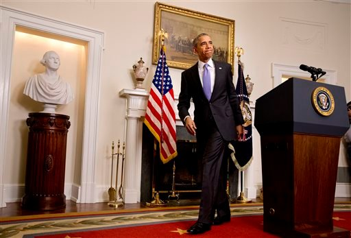 President Barack Obama leaves the podium after speaking about the release of Americans by Iran, Sunday, Jan. 17, 2016, in the Cabinet Room of the White House in Washington. (AP Photo/Jacquelyn Martin)