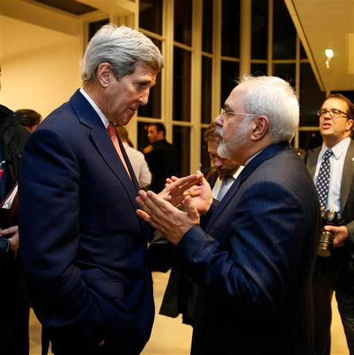 U.S. Secretary of State John Kerry talks with Iranian Foreign Minister Mohammad Javad Zarif, right, after the International Atomic Energy Agency (IAEA) verified that Iran has met all conditions under the nuclear deal, in Vienna, Saturday Jan. 16, 2016. (K